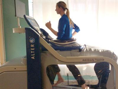 Athlete Running On The AlterG