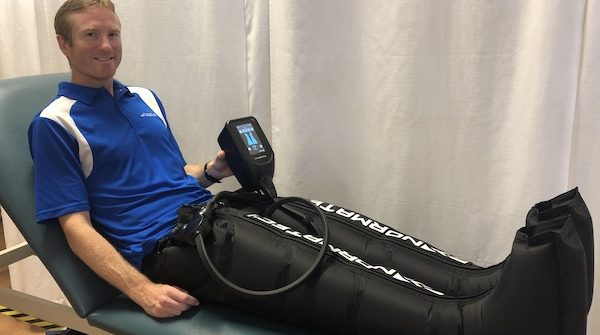 Image Of A Man On The Normatec Product