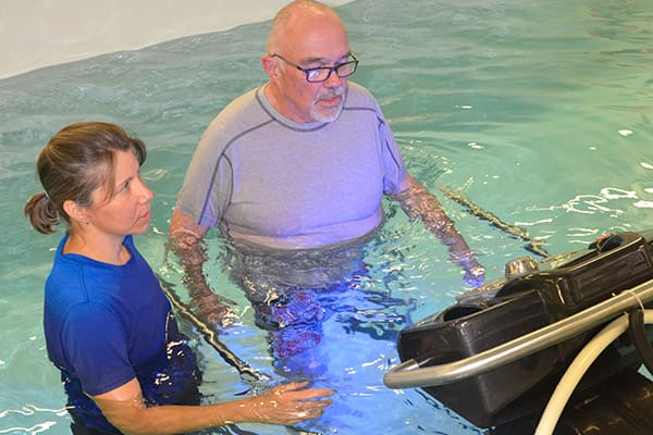 Underwater treadmill training with kinesiologist